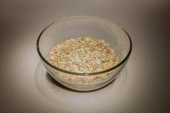 Havremjöl i exponeringsglas Royaltyfri Bild