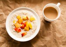 Havremjöl och kaffe arkivfoto