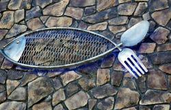 Havs- gaffel för sked för fisk för metall för restaurangteckendesign royaltyfri foto