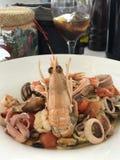 Havs- spagettivän smaskiga Italianfood royaltyfri fotografi