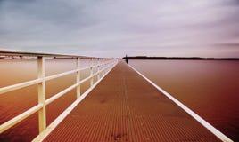 Havsbro på solnedgången Royaltyfria Bilder