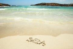 Havsinskrift på sanden Royaltyfri Foto