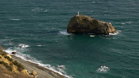 Havskusten vaggar av det heliga fenomenet arkivfilmer