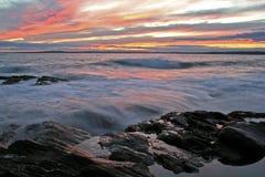 havsolnedgång Arkivfoto