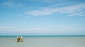 Havssikt med poler Royaltyfri Foto