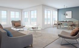 Havssiktsuppehälle och matsal i modernt strandhus Arkivfoto
