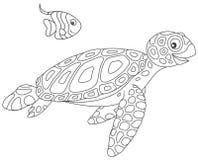 Havssköldpadda och butterflyfish Arkivfoto