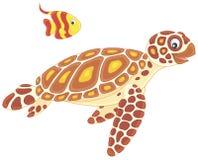 Havssköldpadda och butterflyfish Arkivbild