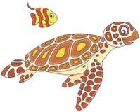 Havssköldpadda och butterflyfish Arkivbilder