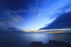 havsskysolnedgång Arkivbild