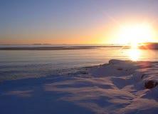havssolnedgångvinter Arkivbild