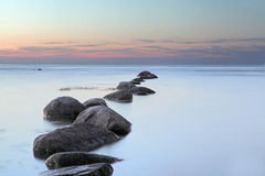 Havssoluppgång i det baltiska havet på Lettland Royaltyfria Foton