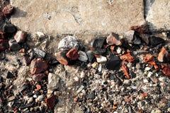 Havsstenar och vågor på stranden Royaltyfri Bild