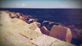 Havsvägg och hav Fotografering för Bildbyråer