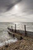 Havsvågbrytare på lä på Solenten UK Royaltyfria Bilder
