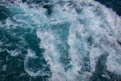 Havyttersida, havsskum på det blåa havet, bakgrund arkivbild