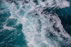Havyttersida, havsskum på det blåa havet, bakgrund arkivfoton