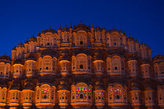 Hawa Mahal the most iconic symbol at Jaipur, capital city of Rajasthan, India. Dusk time with illuminated scenic facade and blue s Stock Photography