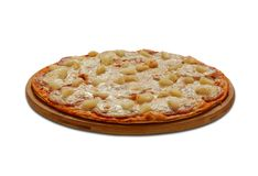 Hawai pizza with pine-apple and chicken fillet. Royalty Free Stock Image