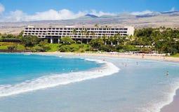 Hawaian  Beach. Tourist sunbathing and surfing on Hapuna Beach Big Island, Hawaii Stock Photo