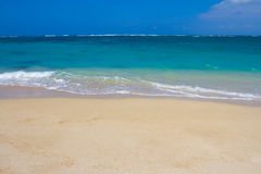 Hawaii Beach Paradise Vacation. Beautiful tropical blue green water and a white sand beach on the north shore of Oahu in Hawaii. This image shows tropical Royalty Free Stock Photo