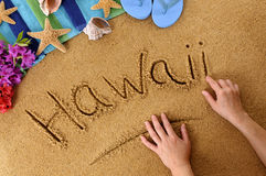 Hawaii beach word writing sand Royalty Free Stock Photos
