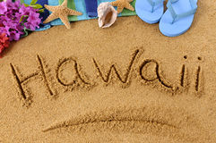 Hawaii beach sand word writing sign Royalty Free Stock Photos