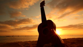 Hawaii concept with ukulele on the beach at sunset stock footage