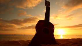Hawaii concept with ukulele on the beach at sunset stock video