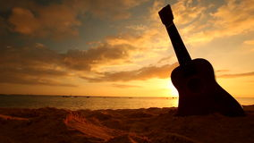 Hawaii concept with ukulele on the beach at sunset. Traditional Hawaiian instrument on sandy beach at sunset on Oahu Hawaii stock footage
