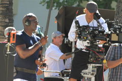 Hawaii 5-0 Crew and Director. Honolulu, Hawaii Jul 30, 2014 TV show Hawaii 5-0 Director Bryan Spicer (center) looks on as the crew films in Waikiki Beach. Jul 30 Royalty Free Stock Image