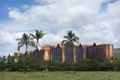 Hawaii Disney Aulani Resort Hotel. Disney Aulani Resort on Oahu Hawaii. Photo perspective from ocean water front looking back towards the resort royalty free stock photos
