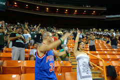 Hawaii fans and marching band cheer for big score in stands at c. HONOLULU, HI - NOVEMBER 22: UNLV vs. UH: Hawaii fans and marching band cheer for big score in Stock Photos