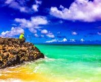 Hawaii Fishing. Lanikai Beach, , Oahu,  Hawaii, USA - September 24, 2015:  Fishing on a beautiful day on the east coast - Kailua - of Oahu.  The natural Royalty Free Stock Photo