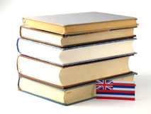 Hawaii flag with pile of books on white background. Hawaii flag with pile of books on white stock photography