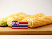 Hawaii flag on a wooden panel with corn isolated on a white back royalty free stock photo