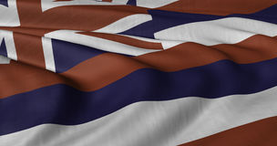 Hawaii flagga som fladdrar i ljus bris Arkivbild