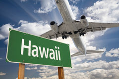 Hawaii Green Road Sign and Airplane Above. With Dramatic Blue Sky and Clouds Stock Photography