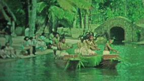 HAWAII 1976: Hawaiian men boat dancers hula in sync in traditional dress. stock video