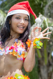Hawaii hula dancer with hat of Santa Claus Royalty Free Stock Photo