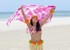 Hawaii hula dancer on a sea beach. Hawaii hula dancer with fluttering scarf on a sea beach Stock Image
