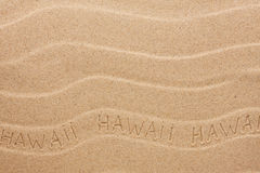 Hawaii  inscription on the wavy sand Stock Image