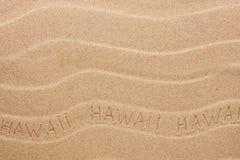 Hawaii inskrift på den krabba sanden Fotografering för Bildbyråer