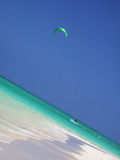 Hawaii Kitesurfer. A kitesurfer skims along the azure waters at Lanikai Beach, Hawaii Stock Image