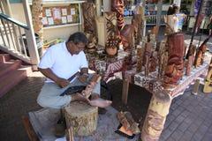 Hawaii Maui. Hawaiian artist carves wood figures at Maui, Hawaii Stock Image