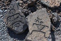 Hawaii Petroglyphs. Figures carved into lava rocks replicating original Native Hawaiian petroglyphs near Mauna Loni resort on the big island of Hawaii stock photos