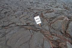 Hawaii road burried by lava rock. Road buried in lava rock from the eruption of Kilauea, Big Island Stock Photos