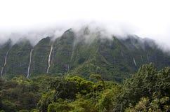 Hawaii Scenery: Rainy Season Mountain Waterfalls. Beautiful scenic tropical waterfalls on the island of Oahu in Hawaii on the misty Koolau Mountains during the Royalty Free Stock Photography