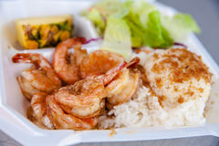 Hawaii shrimp scampi and rice. Photo of popular seafood dish called shrimp scampi. This is butterflied deveined shrimp marinated in a sauce of butter, garlic Royalty Free Stock Photography