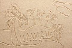 Hawaii som är handskriven från sand royaltyfria bilder